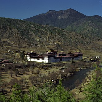 History of Bhutan - View of Tashichoedzong, Thimphu. The 17th-century fortress-monastery on the northern edge of the city, has been the seat of Bhutan's government since 1952.