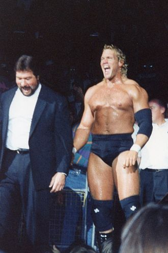 Ted DiBiase - DiBiase managed many wrestlers in his Million Dollar Corporation stable, including Sycho Sid.