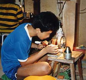 Lapidary - A rural Thai gem cutter (1988 photograph)