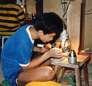 Lapidary - A rural Thai gem cutter (1988 photograph)