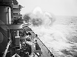 The 16-inch guns on the battleship HMS RODNEY open fire during a practise shoot in the Western Mediterranean, April 1943. A16074.jpg