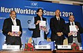 The Minister of State for Human Resource Development, Dr. Shashi Tharoor releasing a publication, at the inauguration of the Gen Next Workforce Summit 2013, in New Delhi on August 23, 2013.jpg
