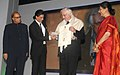 The Super Cinestar Shahrukh Khan presented the first lifetime achievement award of IFFI to the French Film Maker, Mr. Bertrand Tavernier, at the 42nd International Film Festival of India (IFFI-2011), at Ravindra Bhavan.jpg