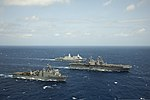 The amphibious dock landing ship USS Rushmore (LSD 47), bottom, amphibious assault ship USS Peleliu (LHA 5), center, and amphibious transport dock ship USS Green Bay (LPD 20) steam in formation in the Pacific 130423-N-ZM744-588.jpg