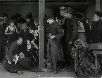 Malcolm Waite - Malcolm Waite (knocked down by Chaplin's Tramp) in The Gold Rush (1925)