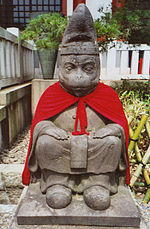 Simian statue at a Buddhist shrine in Tokyo, Japan.