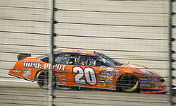 Tony Stewart races by at Texas Motor Speedway.