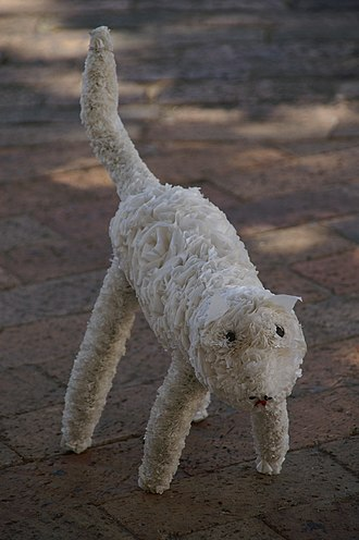 Creative industries - A toy cat produced in a South-African township, made from used plastic bags and old wire
