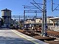 Track replacement works with old Kraków Główny train station in the background, Poland, 2019.jpg