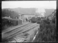 Trains crossing at Kaitoke Station. Class Wb locomotives, 1901 ATLIB 272496.png
