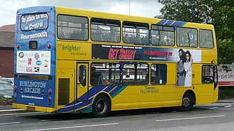 Bus advertising - A bus with a full rear surface advert, and a side panel advert fitted in special guides