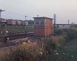 Tuffley Junction signal box A slightly indistinct view of the signal box whose remains can be seen in 556907. This was before the box was replaced by the new Gloucester Power Box. At this point there were 4 main line tracks. The furthest two, signalled with lower quadrant signals, were the former GWR lines from Gloucester Central to Swindon whilst the nearer two, signalled with upper quadrant signals, were the ex-Midland Railway route from Birmingham to Bristol via Gloucester Eastgate. The two sets of lines ran parallel as far a Standish junction and were operated a more or less independent railways! With the resignalling and track rationalisation this stretch was reduced to 2 tracks when the signal boxes closed. The signal box itself was a WWII era structure. Notice also the large telegraph pole routes, one on each side of the tracks, carrying the signalling and telephone circuits.