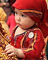 Turkmen child in traditional dress.jpg
