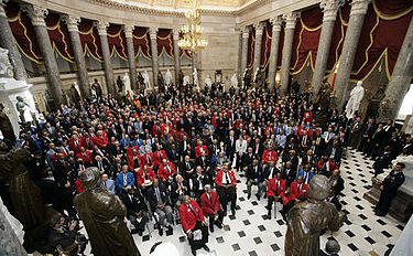 Members of the 99th Fighter Squadron at the Tuskegee Institute, the United States' first squadron of African Americans are honored at the National Statuary Hall, 2007. Tuskegee Airmen at the US Capitol, 2007March29.jpg