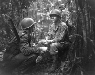J. Lawton Collins - On the right, Major General J. L. Collins, commander of the 25th Division and, on the left, Major Charles W. Davis, commanding the 3rd Battalion, 27th Infantry Regiment confer on New Georgia, August 14, 1943.