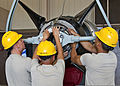U.S. Air Force Airman Justin Trathen, Airman Christian Botello and Airman Samuel Kwon, all in the jet propulsion course with the 361st Training Squadron, install a propeller lifting adapter for the removal of 130827-F-NS900-008.jpg