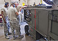 U.S. Air Force Senior Airmen Alfred Fyvie, Joshua Ruberg and Mister Braxton, all with the 361st Training Squadron, check the instruction manual to troubleshoot an electrical problem June 8, 2011, at Sheppard Air 110608-F-NS900-032.jpg
