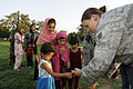 U.S. Army Capt. Marie Orlando, background, a public affairs officer with an agriculture development team, watches Air Force Senior Airman Alexandra Hess, foreground, a vehicle operator assigned to the Nangarhar 100821-F-FW394-068.jpg