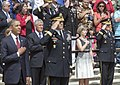 U.S. Army Gen. Martin E. Dempsey, front right, the chairman of the Joint Chiefs of Staff, and his wife, Deanie, front row, second from right, render honors during the playing of the national anthem for the 145th 130527-D-HU462-142.jpg