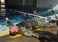 U.S. Army Lt. Col. John Warner lies on the ground after completing a relay swim race at Camp Lemonnier in Djibouti Oct. 5, 2013 131005-N-LE393-074.jpg