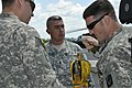 U.S. Army Sgt. Nick Niehoff, right, attaches a hoist to a piece of extraction equipment during rescue training at the Army Aviation Support Facility in New Castle, Del., Aug. 4, 2013 130804-Z-DL064-007.jpg