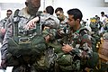 U.S. Army Staff Sgt. Jacob Sheets gets help donning a parachute from an Indian Army paratrooper during Yudh Abhyas 2013.jpg