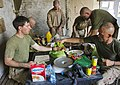 U.S. Marines preparing food for dinner at Patrol Base Jaker, Afghanistan.jpg