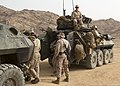 U.S. Marines with Weapons Company, Battalion Landing Team, 3rd Battalion, 2nd Marine Regiment, 26th Marine Expeditionary Unit (MEU) prepare a light armored vehicle for a mission June 8, 2013, in Al Quweira 130608-M-BS001-005.jpg