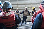 U.S. Navy Boatswain's Mate 2nd Class Eric Santiago, center, briefs personnel before conducting a combat rubber raiding craft recovery exercise in the well deck of the amphibious assault ship USS Bonhomme 130808-N-KE519-021.jpg