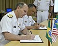 U.S. Navy Chief of Naval Operations Adm. Jonathan W. Greenert, foreground, and Commander of the Brazilian Navy Adm. Julio Soares de Moura Neto sign an agreement continuing the Military Personnel Exchange Program 130116-N-ZI511-685.jpg