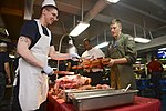 U.S. Navy Culinary Specialist 3rd Class Ryan Aulman serves freshly cooked meat during a Sunday brunch on the mess decks aboard the aircraft carrier USS Nimitz (CVN 68) in the Indian Ocean June 9, 2013 130609-N-TW634-030.jpg