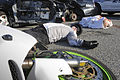 U.S. Navy Machinist's Mate 2nd Class Ashly Gaskill, assigned to the aircraft carrier USS Abraham Lincoln (CVN 72), portrays a victim in a distracted driving crash simulation display Dec. 12, 2013 131212-N-YB832-014.jpg