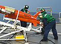U.S. Sailors assigned to the targets detachment at Fleet Activities Okinawa, Japan, check on a BQM-74 target drone on the flight deck of the amphibious dock landing ship USS Tortuga (LSD 46) during a missile 130525-N-IY633-104.jpg