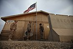 U.S. Sailors attach a U.S. flag to a pole outside the Naval Mobile Construction Battalion 15 battalion aid station at Camp Leatherneck, Afghanistan, June 28, 2013 130628-M-TM093-014.jpg