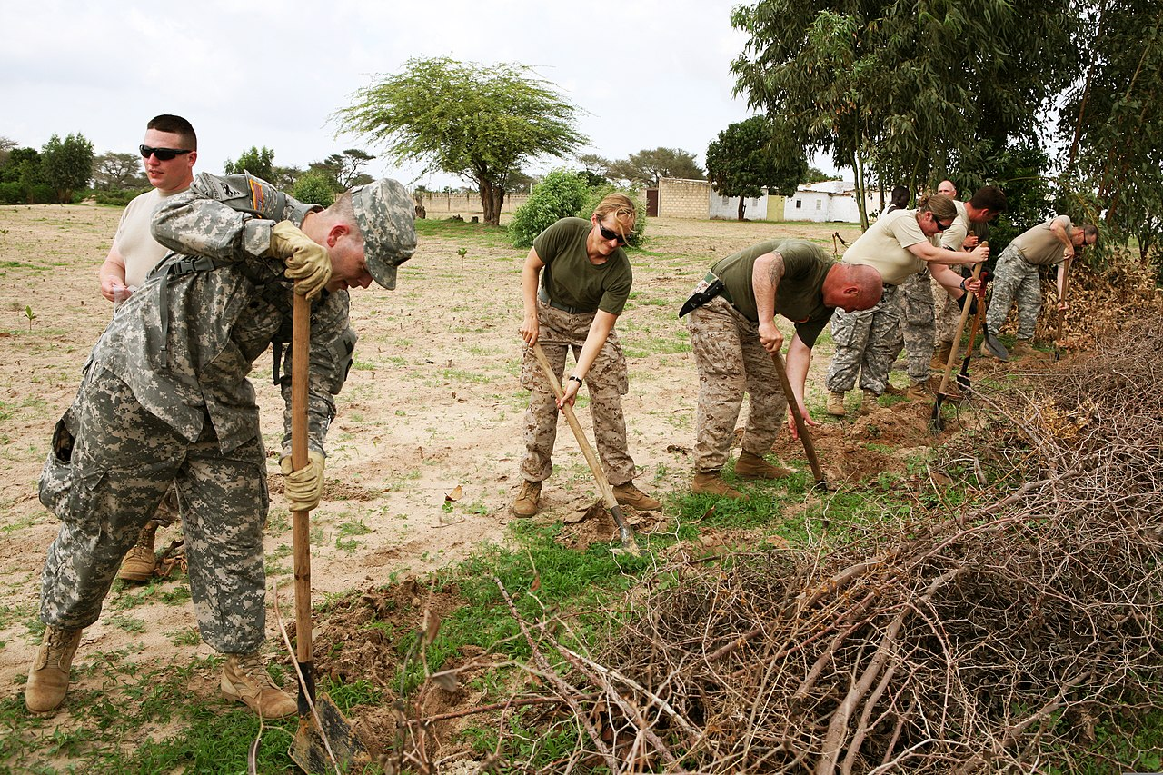File:U S  Service members dig a trench in order to plant a