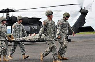 Oregon Military Department - Oregon National Guardsmen simulate the evacuation of a casualty during a training exercise.