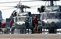US Navy 030216-N-7265L-026 Aviation Ordnancemen aboard USS Carl Vinson (CVN 70) load equipment into two waiting HH-60H Seahawks assigned to the.jpg