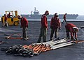US Navy 030407-N-6817C-040 Sailors aboard USS Abraham Lincoln (CVN 72) work to transfer ammunition and supplies from the ship's flight to the aircraft carrier USS Nimitz (CVN 68).jpg