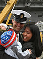 US Navy 030919-N-5362F-098 Navy Chief Petty Officer is greeted by his wife and child.jpg