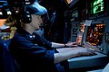 US Navy 031105-N-3725R-001 During the Battle Group Inport Exercise (BGIE) Operation Specialist 2nd Class Joseph Juracka checks for hostile and friendly contacts in a virtual combat environment.jpg
