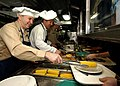 US Navy 040411-N-6278K-086 Department Heads assigned to the nuclear powered aircraft carrier USS George Washington (CVN 73) serve crew members Easter dinner in the ship's galley.jpg