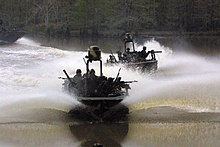 US Navy 040421-N-0000R-002 Special Warfare Combatant Crewmen (SWCC) assigned to Special Boat Team Twenty-Two demonstrate the new Special Operations Craft-Riverine (SOC-R).jpg