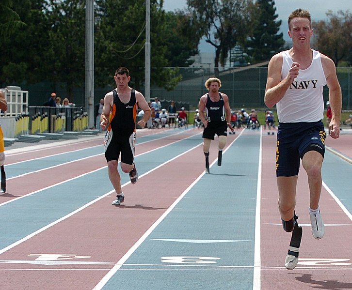 File:US Navy 040521-N-2653P-302 Cryptologic Technician Interpreter 2nd Class Casey Tibbs, wins a 100-meter race while qualifying for the U.S. Paralympics Sprint Team.jpg