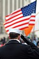 US Navy 050120-N-0962S-140 A Sailor lining the street cordon down Pennsylvania Avenue salutes the American flag as it passes during the Inauguration Day Parade held in Washington, D.C.jpg