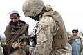 US Navy 050213-M-4697Y-083 U.S. Navy Hospital Corpsman 3rd Class Christopher Hogans treats a dog bite on a local Afghan man's hand during a security patrol in Khowst Province, Afghanistan.jpg
