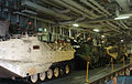 US Navy 050615-N-9866B-005 Marines assigned to the 3rd Amphibious Assault Battalion, stationed at Camp Pendleton, Calif., relax on their amphibious assault vehicles after embarking aboard the amphibious assault ship USS Peleliu.jpg
