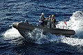 US Navy 050622-N-5781F-055 A Rigid Hull Inflatable Boat (RHIB) returns to the guided missile cruiser USS Cowpens (CG 63) after conducting exercises in the Coral Sea.jpg
