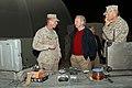 US Navy 051124-M-1327J-035 Senator Joseph Lieberman (D-CT) is briefed by U.S. Marine Corps Chief Warrant Officer Timothy Callahan at Camp Taqaddum in Iraq.jpg
