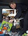 US Navy 051206-N-6843I-075 A Los Angeles Police Department (LAPD) officer sorts through gifts to be donated to patients and family members at Naval Medical Center San Diego (NMCSD).jpg