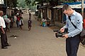 US Navy 060116-N-8637R-002 Journalist 2nd Class Michael Zeltakalns assigned to the American Forces Network Detachment, Sigonella, Sicily, shoots video of the people in Monrovia.jpg